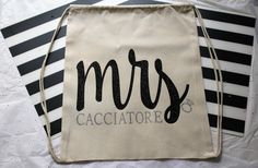 Mrs. personalized large drawstring tote backpack! My custom tote bags make the perfect addition to your bachelorette party, birthday party, destination wedding, retirement party, classroom gift, teacher gift and so much more! Bags measure 14 inches wide x 18 inches high. You can add any name or saying to the bag.
