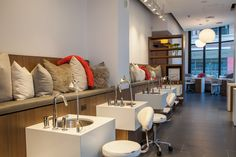 Light and modern manicure and pedicure nail room.