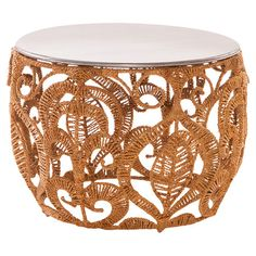 Featuring a wrought iron frame and intricate rope detailing, this eye-catching accent table is the perfect spot to display a vase of bright blooms or your fa...