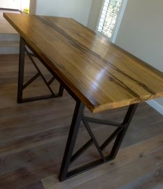 We made the top out of reclaimed black limba originally sourced from Africa's forests.