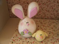 """Here's a cute and whimsical little Easter duo. The set consists of a chubby little bunny adorned with a lavender colored flower and his little sidekick...a yellow chick. The bunny stands about 2 1/2"""" tall...the chick is not quite an inch. The pair has been lightly dusted with extra fine glitter and lightly glazed with a satin glaze.  They are original designs, handcrafted from polymer clay. $8.95"""