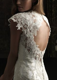 Backless wedding dress with capped sleeve.