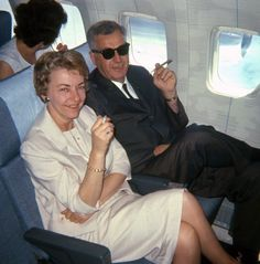 My friend's folks stretch out and light up on a nice, comfy flight from San Francisco to Hawaii in 1965. Someone borrowed their Kodak Instamatic for this 126 Kodachrome slide.