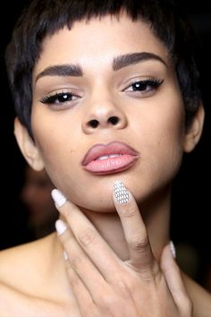 Nails, by Miss Pop Nails, were adorned with a net lace effect.