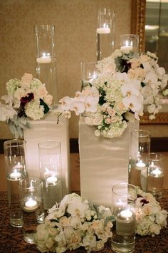 January Wedding Ceremony ideas, January wedding Floral Design, New Years wedding glass candle decor ideas, winter wedding flowers decor, 2014 valentine's day ideas www.loveitsomuch.com