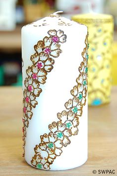 henna and glitter decorated candle by Joyful