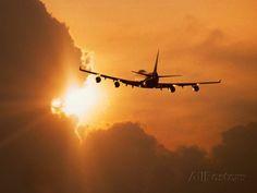 Jumbo jet banking into the sunset. Airplane Art Print ~ photographer unknown