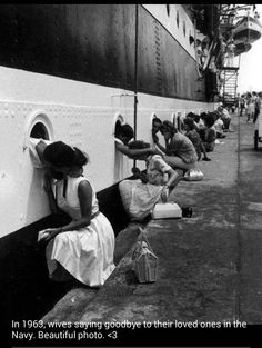 Woman saying goodbye to there husbands going off to war through the port holes of the ship..