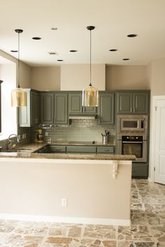 Beautiful Kitchen Redo #gray #amber #glass  LOVE that it is something DIFFERENT