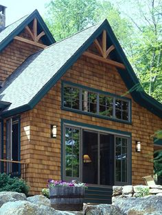 Cedar Siding stained red | Timber Frame Home Siding Options | Board and Batten to Cedar Shingles