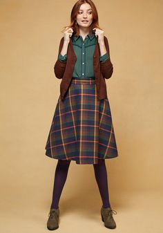 <p>Attend lectures and presentations with straight-A style in this navy blue skirt! Part of our ModCloth namesake label, this plaid midi comes with handy pockets, a silky lining, and a collection of orange, yellow, and clay hues, giving you all the 'demure' reason to excel in and outside of class!</p>