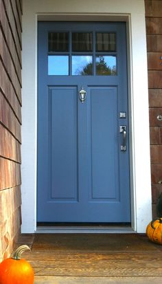 A medium #BluePaint color works well for a front door surrounded by natural wood siding.  Here's Mineral Alloy by Benjamin Moore.  It really stands out with the white trim surrounding it.