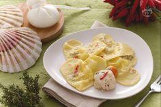 I cuori di burrata sono ravioloni di pasta fresca ripieni di morbida burrata, avvolti da una deliziosa salsa di capesante. Ideali per San Valentino.