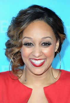 Tia Mowry Side Swept Curls - Tia Mowry looked lovely at the NBC Universal 2012 Winter TCA Press Tour wearing her hair in a simple bobby-pinned updo with pretty side-swept curls.