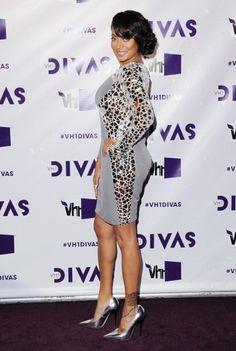 LaLa Anthony wearing a custom made Cd Greene gray glass mirror long sleeve dress.