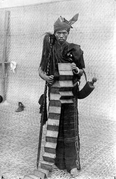 Portrait of a datu with divinitation book, medicine horn and magic staff