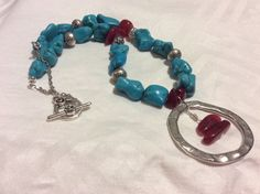 Turquoise, cherry quartz , pewter and plated metal necklace.