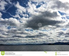 Photo about A bright sunny day on Lake Champlain in Vermont with thick puffy bright clouds going deep into the horizon. Image of sunny, cumulus, adirondak - 71097030 Lake Champlain Vermont, League Of Angels, Sunny Days, Clouds, Stock Photos, Image, Cloud