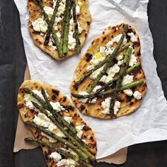 Tender grilled asparagus and soft ricotta cheese top this grilled pizza. No grill? no problem. Cook this dough in a cast-iron skillet over high heat, or on a preheated sheet pan or pizza stone in a 500-degree oven.