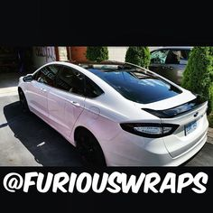 Awesome Ford: Ford Fusion : Roof+Spoiler Wrap & custom tail light tint. Looks like a completely different car. Gr - furiouswraps... Car stuff