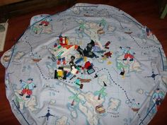 How to make a drawstring playmat. Very handy for Legos, etc.  Like this but with the drawstring enclosed...