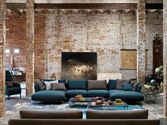 brick wall blue sofa