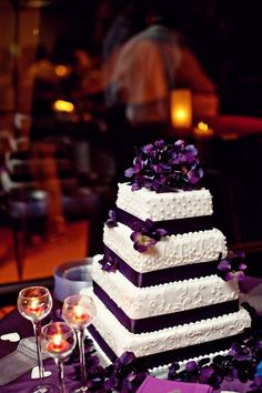Purple wedding cake. Would love to have this with some orange/pink flowers put on it