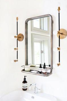 Modern bathroom features a Restoration Hardware Astoria Mirror with Shelf illuminated by brass linear sconces Apparatus Studio Vanity Sconces over a pedestal sink. Bad Inspiration, Bathroom Inspiration, Small Bathroom, Master Bathroom, Bathroom Mirrors, Bathroom Ideas, White Bathroom, Brass Bathroom, Ikea Bathroom