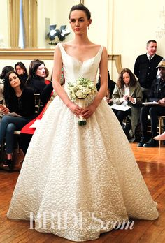 """Brides.com: . """"Asia"""" ball gown in 3D optic organza with sequins with a deep-V neckline by Peter Langner"""