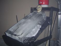 "Skull Ice Luge'  -  2x4 frame constructed w/ 3"" deck screws.  platform for 5 gallon jug, a hollow skull prop was modified to fit a funnel in the back/top of the skull, then through the teeth, making it like a skull was spitting the liquor shot down the block of ice.  WARNING:  the ice can weigh 100 - 300 lbs depending on size.  This can be dangerous if not properly secured."
