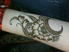 "Henna arm tattoo -- makes the traditional ""mango"" shape using a flower & crescent"