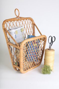 Wicker hanging book/magazine holder by thisvintagething on Etsy, $39.99