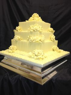 - 3 tiers all chocolate sponge with white belgiam chocolate curls,fans,roses and cigarellos