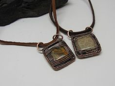 16 gauge wire for frame, 24 gauge for wire wrapping, flat square glass bead/stone center piece and the rest could be figured out by looking at the picture!