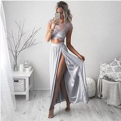 It is really a beautiful dress.This dress with up lace and down polyester design,besides,the slit design is a bonus point.It can show your perfect figure. Material:Polyester, Lace Size:S,M,L Color:Whi