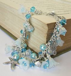 SOLD!  Delicate lucite flower & pearl bead Charm bracelet handcrafted by White Raven Designs for Ravenshires Realm