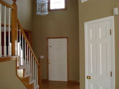 Ridding your House of Honey Oak -- white trim to the rescue!