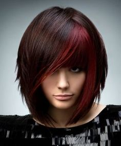 I am in love with the color of her hair!!! And actually, I like the cut and style too. I wish I could get away with this color.