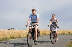 From the movie The Reader, David Kross/Michaeil Berg and Kate Winslet/Hanna Schmitz riding their bikes.
