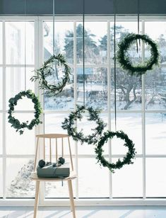 Simple wreaths hanging in the window - Scandinavian style and Christmas decor - minimalistic holiday decor www.pencilshavingsstudio.com