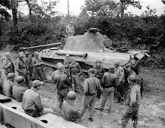 US troops inspect destroyed German tanks Normandy area 1944