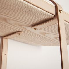 Tomás Alonso shelf detail: brass hardware, ash timber with leather saddlery techniques