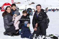 Prince Joachim and Princess Marie of Denmark took a break from their skiing holiday in Villars, Switzerland, to pose for pictures high atop the Col de Bretaye,with their family