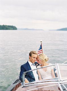 Couple in Boat | Photo: Tec Petaja. View More:  http://www.insideweddings.com/weddings/childhood-friends-celebrate-wedding-at-marriott-familys-lake-house/866/