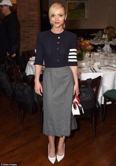 Simple: Christina Ricci paired a nautical-inspired cardigan with a grey skirt and white heels
