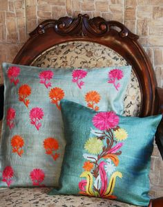 Raw silk pillow covers in jewel tones, traditional Indian prints.