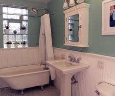 bead board in bathroom?..not a huge fan of the paint color or window but love everything else