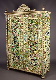 Remarkable tiles mosaic armoire ca. 1910  antique wood armoire decorated with numerous pieces of ceramic tiles, glass beads and rhinestones. each piece fixed on plaster undercoat.