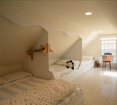 Excellent usage of space. This idea is perfect for an attic room.