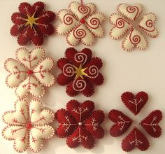 Felt hearts stitched into snowflake ornaments. Felt Christmas Decorations, Felt Christmas Ornaments, Christmas Wreaths, Snowflake Ornaments, Heart Ornament, Snowflakes, Christmas Makes, Noel Christmas, Christmas Projects